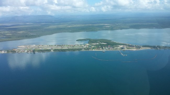 Placencia peninsula, Belize (looking west). Natcore has been engaged to oversee development of a 10 MW power system on a site across the lagoon from the peninsula.